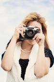 Woman with vintage camera — Stock Photo