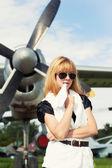 Woman holding paper plane — Stock Photo