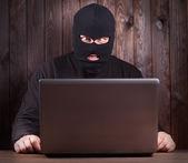 Hacker in a balaclava  — Stockfoto