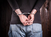 Man hands in handcuffs — Stock Photo