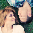 Couple laying on the grass — Stock Photo #50498977