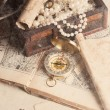 Treasure chest, compass and old map — Stock Photo #50499265