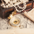 Treasure chest, compass and old map — Stock Photo #50499267