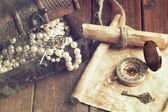 Treasure chest, compass and old map — Stock Photo
