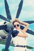 Beautiful woman  against plane — Foto de Stock