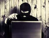 Hacker in a balaclava — Photo