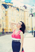 Woman posing on a city street — Stock Photo