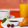 Breakfast with croissant, coffee and juice — Stock Photo