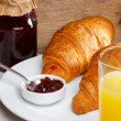 Breakfast with croissant and juice — Stock Photo