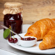 Croissant with jam — Stock Photo #13758943