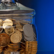 Jar with coins — Stock Photo