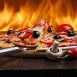 Hot pizza with oven fire on background — Stock Photo #13759207
