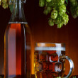 Beer with brewery hop and wheat still life - Stock Photo