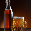 Stock Photo: Beer bottle and mug on wooden table still life