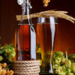 Beer with hop and wheat on wooden table still life — Stock Photo #13759237