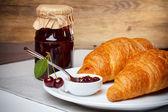 Croissant with jam — Stock Photo