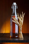Beer bottle with wheat — Stock Photo
