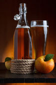 Apple cider glass and bottle with apples still life — Stock Photo