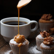 Cupcake with nuts and flowing caramel — Stock Photo