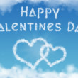 Valentines day greeting card with heart shaped clouds — Stock Photo