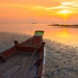 Stock Photo: Small fishermans boat at sunset during ebb, focus on boat