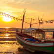 Old fishermans boat at sunset, during sea ebb — Stock Photo