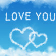 Stock Photo: Valentines day greeting card with heart shaped clouds