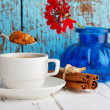 Coffee with caramel sugar and cinnamon on wooden table — Stock Photo