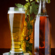 Beer with hop on wooden table still life — Stock Photo