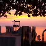 Beach restaurant dinner setting at sunset — Stock Photo #27197011