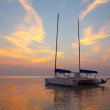 Catamaran on tropical beach at sunset — Stock Photo