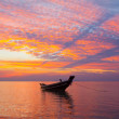 Small wooden fisherman boat at sunset — Stock Photo