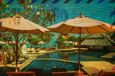 Vintage card with tropical resort — Stock Photo
