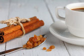 Coffee with caramel sugar and cinnamon on wooden table close up — Stock Photo
