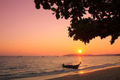 Longtail boat in Andaman sea at sunset, Thailand — Stock Photo