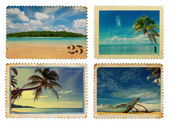 Vintage postage stamps with tropical palms and island — Stock Photo