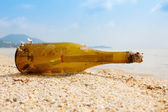 Bottle with a message on tropical shore — Stock Photo