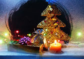 Christmas gifts still-life inside snowy window — Stock Photo