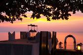 Beach restaurant dinner setting at sunset — Stock Photo