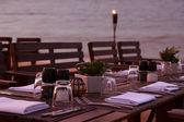 Evening beach dinner serving — Stock Photo