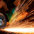 Stock Photo: Grinding iron with spark