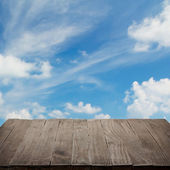 Empty wooden table with blue sky — Stock Photo