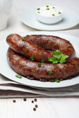 Traditional homemade coiled sausage — Stock Photo