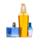 Perfume and oil bottle isolated on white — Stock Photo