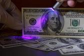 Dollar bill in uv light — Stock Photo