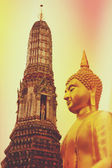 Vintage toned Buddha statue at Wat Arun — Stock Photo