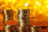 Stack of golden ukrainian coins — Stock Photo
