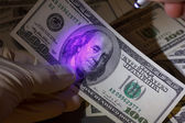 Dollar bill in uv light — Stock Photo