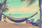 Hammock under palms trees — Stock Photo