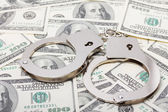 Handcuffs on money — Stock Photo